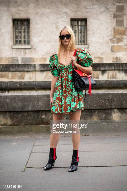 Charlotte Groeneveld wearing a green and brown mini dress black boots and black and red Valentino bag is seen outside Valentino on Day 7 Paris...