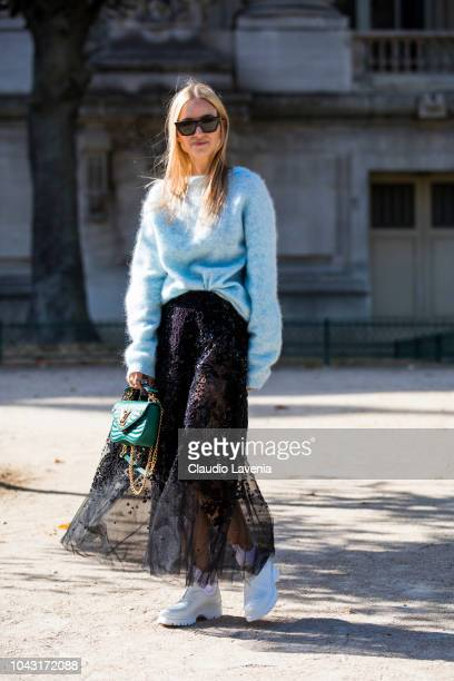 Charlotte Groeneveld wearing a light blue jumper black lace maxi skirt white boots and green Louis Vuitton bag is seen before the Elie Saab show on...