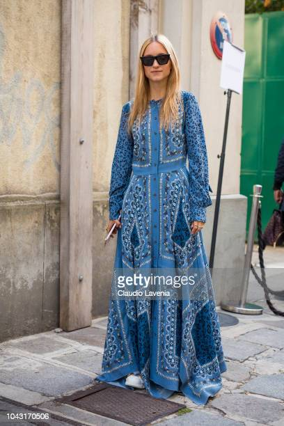 Charlotte Groeneveld wearing a maxi light blue printed dress is seen after the Altuzarra show on September 29 2018 in Paris France