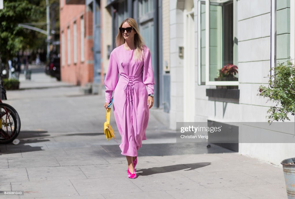 Charlotte Groeneveld wearing a pink dress seen in the streets of Manhattan outside Tibi during New York Fashion Week on September 9, 2017 in New York City.