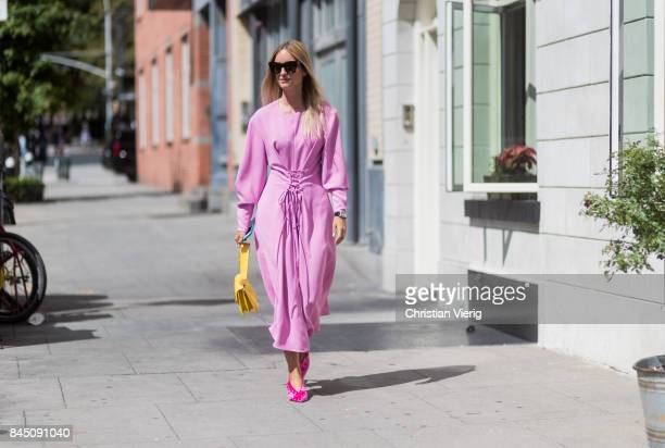 Charlotte Groeneveld wearing a pink dress seen in the streets of Manhattan outside Tibi during New York Fashion Week on September 9 2017 in New York...