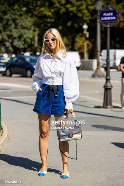 Charlotte Groeneveld wearing a white Chanel shirt blue shorts seethrough Chanel bag and white and blue Chanel shoes is seen outside Chanel show...