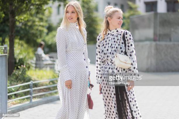 Charlotte Groeneveld wearing a white dress with slit and Courtney Trop seen in the streets of Manhattan outside Zimmermann during New York Fashion...
