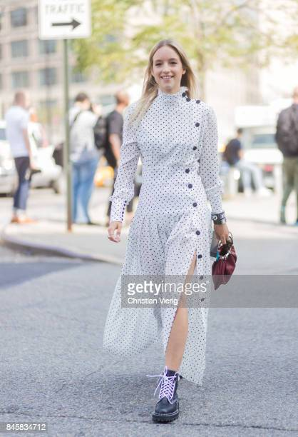 Charlotte Groeneveld wearing a white dress with slit seen in the streets of Manhattan outside Zimmermann during New York Fashion Week on September 11...
