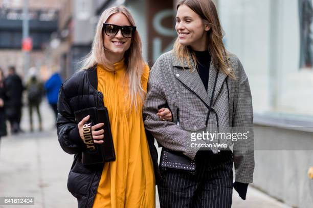 Charlotte Groeneveld wearing a yellow dress black down feather jacket Dior clutch and Sabrina Meijer outside Tibi on February 11 2017 in New York City