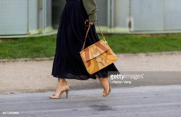 Charlotte Groeneveld wearing an olive turtleneck black skirt Chloe bag heels outside Chloe on March 2 2017 in Paris France