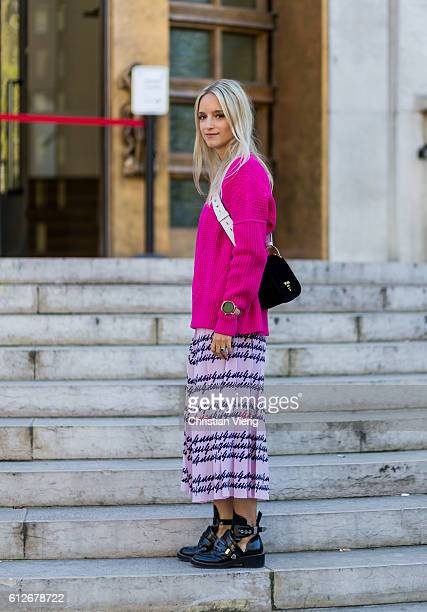 Charlotte Groeneveld wearing Balenciaga boots a pink sweater and Prada bag outside Ellery on October 4 2016 in Paris France