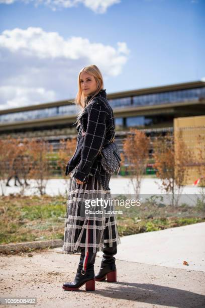 Charlotte Groeneveld wearing black and white checked coat and skirt is seen before the Christian Dior show on September 24 2018 in Paris France