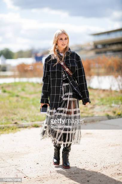 Charlotte Groeneveld wearing checked jacket and skirt is seen outside Dior during Paris Fashion Week Womenswear Spring/Summer 2019 on September 24...