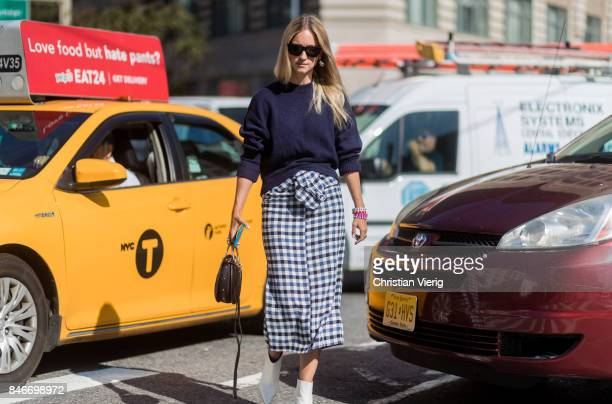 Charlotte Groeneveld wearing checked skirt seen in the streets of Manhattan outside Michael Kors during New York Fashion Week on September 13 2017 in...