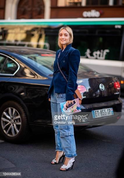 Charlotte Groeneveld wearing denim jeans velvet blazer sandals is seen outside Stella McCartney during Paris Fashion Week Womenswear Spring/Summer...