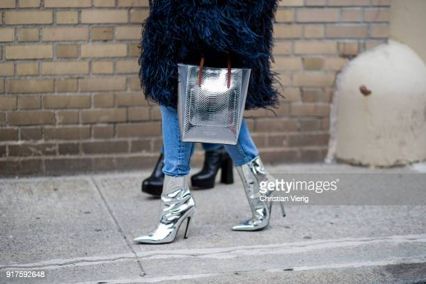 Charlotte Groeneveld wearing navy fake fur coat silver bag silver boots cropped denim jeans seen outside Ralph Lauren on February 12 2018 in New York...