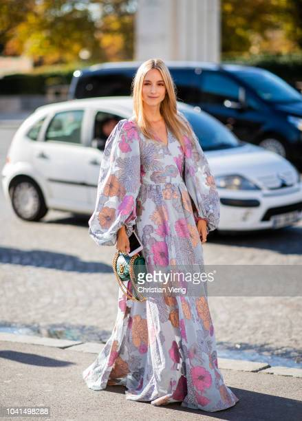 Charlotte Groeneveld wearing oversized dress with floral print, green Louis Vuitton wave bag is seen outside Rochas during Paris Fashion Week...