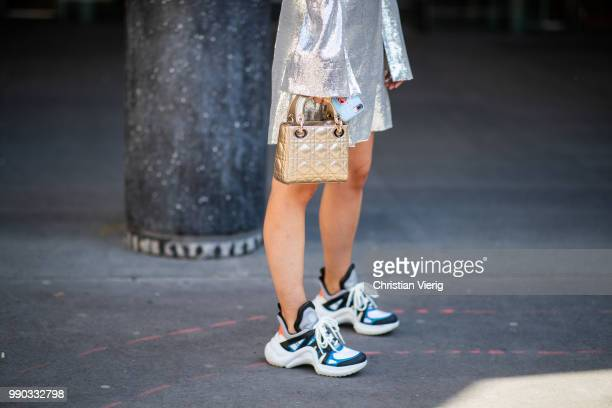 Charlotte Groeneveld wearing silver dress Louis Vuitton sneakers Dior bag seen outside Ralph Russo on day two during Paris Fashion Week Haute Couture...