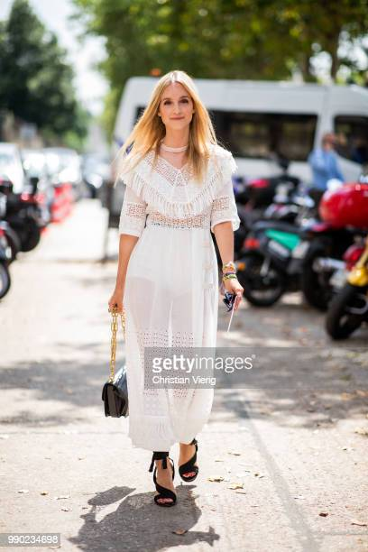 Charlotte Groeneveld wearing white sheer dress is seen outside Dior on day two during Paris Fashion Week Haute Couture FW18 on July 2 2018 in Paris...