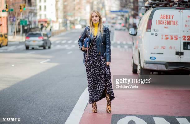 Charlotte Groeneveld wearing yellow turtleneck black dress leather jacket seen outside Tory Burch on February 9 2018 in New York City