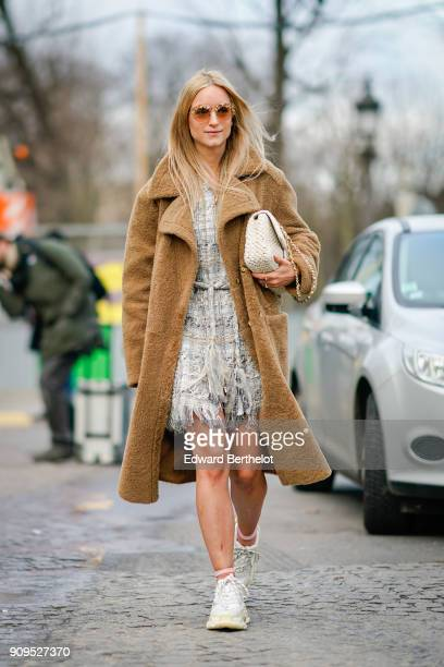 Charlotte Groeneveld wears a brown fluffy coat sunglasses a dress sneakers outside Chanel during Paris Fashion Week Haute Couture Spring/Summer 2018...
