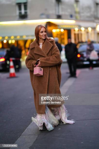 Charlotte Groeneveld wears a brown long winter fluffy coat a cube shaped pink bag a long fringed dress outside Viktor Rolf during Paris Fashion Week...