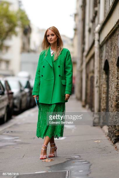 Charlotte Groeneveld wears a green button jacket a green lace skirt silver lace shoes outside Valentino during Paris Fashion Week Womenswear...