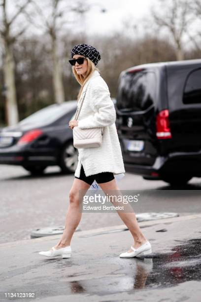 Charlotte Groeneveld wears a tweed beret a white tweed jacket a padded Chanel bag outside Chanel during Paris Fashion Week Womenswear Fall/Winter...