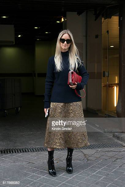 Charlotte Groeneveld wears Dior boots and bag on day 4 during Paris Fashion Week Autumn/Winter 2016/17 on March 4 2016 in Paris France Charlotte...