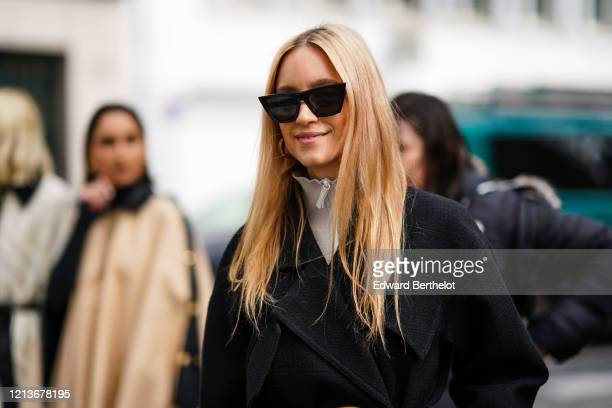 Charlotte Groeneveld wears sunglasses, a black coat, a turtleneck top, outside Altuzarra, during Paris Fashion Week - Womenswear Fall/Winter...