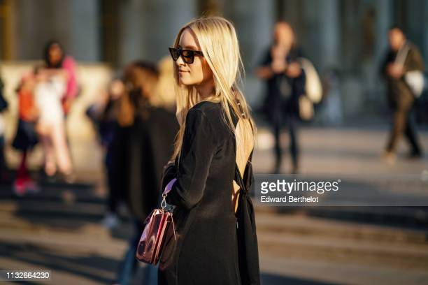 Charlotte Groeneveld wears sunglasses, a pink silver shiny bag, a black fringed backless dress outside Rochas, during Paris Fashion Week Womenswear...