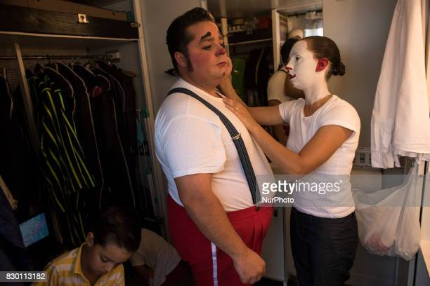 Charlotte helps her partner Totti clown to make up before the adrenaline show of the Quimera circus On 10 August 2017 in Santander Spain The...