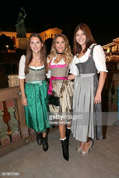Charlotte Hermann and her sister Sophie Hermann and stepsister Julia Tewaag Julia Frank daughter of Uschi Glas during the Oktoberfest at...