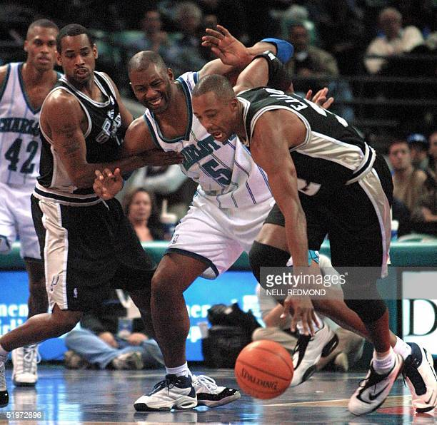 Charlotte Hornet Elden Campbell loses the ball to San Antonio Spur Sean Elliott as he is doubleteamed by Elliott and Derek Anderson in the second...