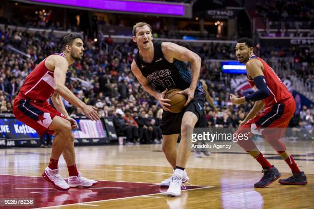 Charlotte Hornets Cody Zeller recovers a loose ball against the Washington Wizards at the Capitol One Arena in Washington United States on February...