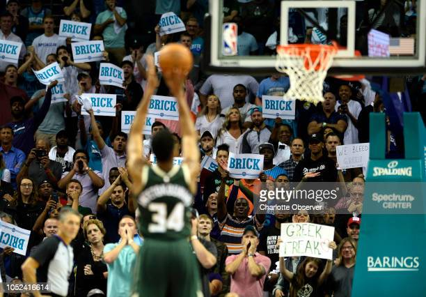Charlotte Hornets fans try to distract Milwaukee Bucks forward Giannis Antetokounmpo as he shoots free throws in the second half at the Spectrum...