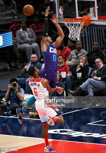 Charlotte Hornets forward Miles Bridges cannot come up with a pass at the basket against Washington Wizards guard Troy Brown Jr n November 22 2019 at...