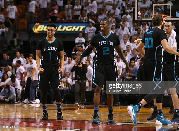 Charlotte Hornets guard Courtney Lee and Marvin Williams celebrate after they beat the Miami Heat 9088 on Wednesday April 27 at AmericanAirlines...