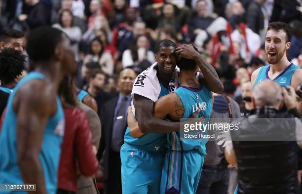 TORONTO ON MARCH 24 Charlotte Hornets guard Jeremy Lamb is mobbed by teammates after throwing up a desperation three pointer just before the buzzer...