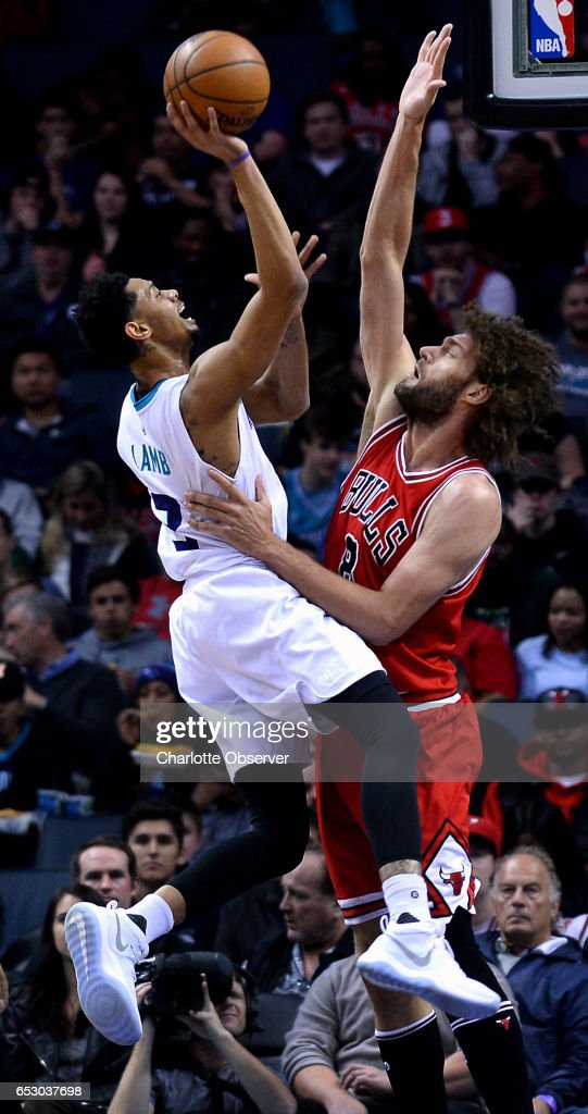 Charlotte Hornets guard Jeremy Lamb, left, releases a two-point basket over Chicago Bulls center Robin Lopez, right, during first half action on Monday, March 13, 2017 at the Spectrum Center in Charlotte, N.C.