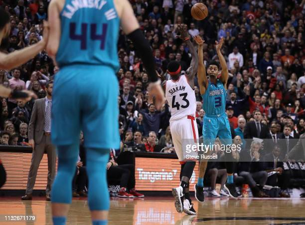 TORONTO ON MARCH 24 Charlotte Hornets guard Jeremy Lamb throws up a desperation three pointer just before the buzzer from the half as Toronto Raptors...