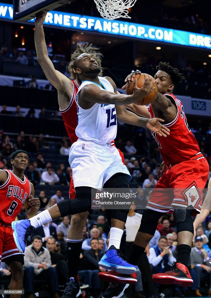 Charlotte Hornets guard Kemba Walker, center, has his shot blocked by Chicago Bulls forward Jimmy Butler, right, on a drive to the basket during second half action against the Chicago Bulls on Monday, March 13, 2017 at the Spectrum Center in Charlotte, N.C. The Bulls defeated the Hornets 115-109.