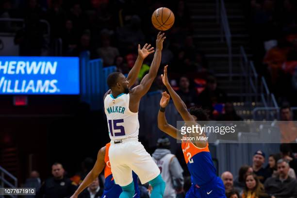 Charlotte Hornets guard Kemba Walker shoots over Cleveland Cavaliers guard Collin Sexton during the second half at Quicken Loans Arena on November 13...