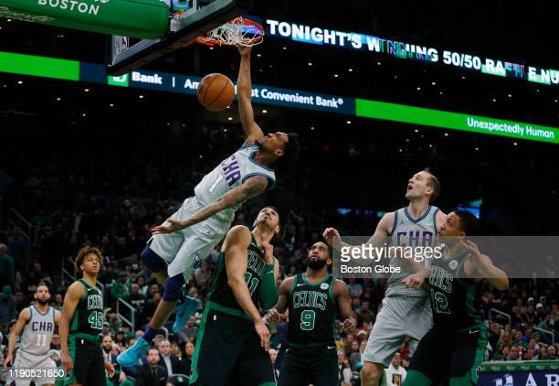 Charlotte Hornets guard Malik Monk dunks in front of Celtics guard Romeo Langford center Enes Kanter guard Brad Wanamaker and forward Grant Williams...