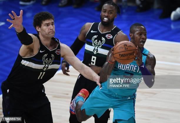 Charlotte Hornets guard Terry Rozier controls the ball as Milwaukee Bucks centre Brook Lopez and Milwaukee Bucks guard Wesley Matthews defend during...