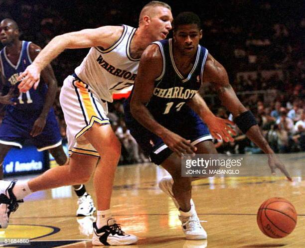 Charlotte Hornets Kendall Gill tries to dribble by Golden State Warriors Chris Mullin during the first period in Oakland California 19 December The...