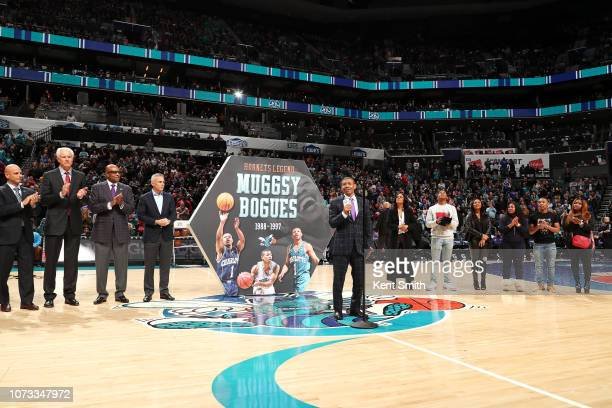 Charlotte Hornets legend Muggsy Bogues is recognized for his achievements with the team during halftime on December 14 2018 at Spectrum Center in...