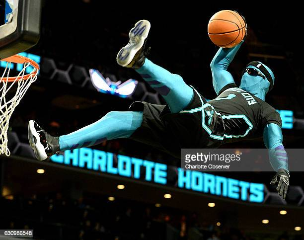 Charlotte Hornets mascot Super Hugo dunks during a timeout in the team's game against the Oklahoma City Thunder at the Spectrum Center in Charlotte...