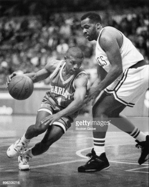 Charlotte Hornets Muggsy Bogues left attempts to dribble past Boston Celtics John Bagley right during a game at the Boston Garden Nov 1 1991
