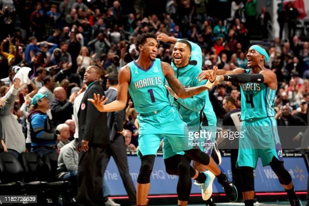 Charlotte Hornets players react to Malik Monk of the Charlotte Hornets hitting the game winning shot against the Detroit Pistons on November 15 2019...