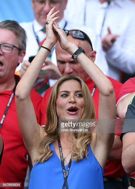 Charlotte Jackson, wife of Wales manager Chris Coleman, applauds during the UEFA Euro 2016 Round of 16 match between Wales and Northern Ireland at...