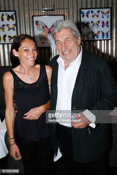 Charlotte Joly and actor JeanPierre Castaldi attend the 'Street Art butterflies' by Charlotte Joly Exhibition Preview at Veramente on June 15 2018 in...