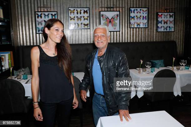 Charlotte Joly and her uncle Alain Belmondo attend the Street Art butterflies by Charlotte Joly Exhibition Preview at Veramente on June 15 2018 in...