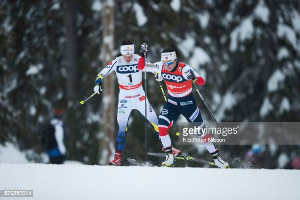 Charlotte Kalla of Sweden and Marit Bjorgen of Norway during the ladies cross country 10K pursuit competition at FIS World Cup Ruka Nordic season...